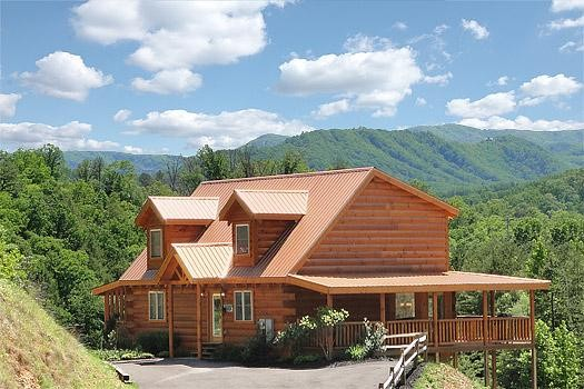 A cabin with the Smoky Mountains in the background.