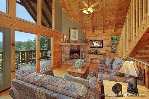 The living room of a Smoky Mountain cabin rental with a fireplace.