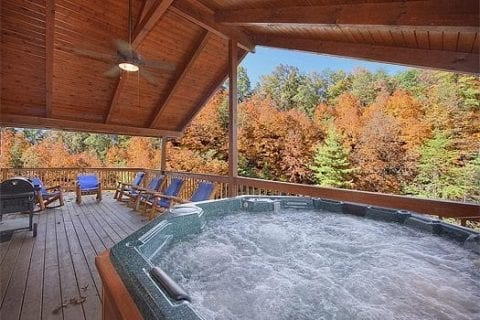 A hot tub on the deck of a Smoky Mountain cabin rental.