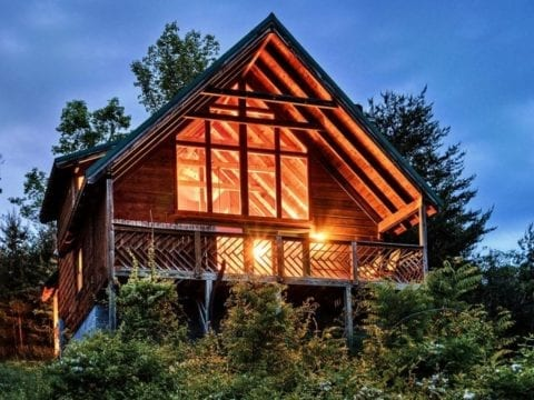 Bright lights shining from a Smoky Mountain cabin rental.