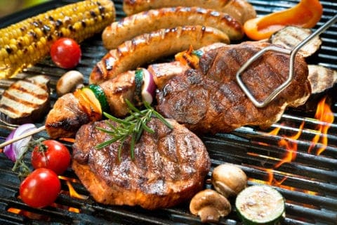 Meats and vegetables on the grill.