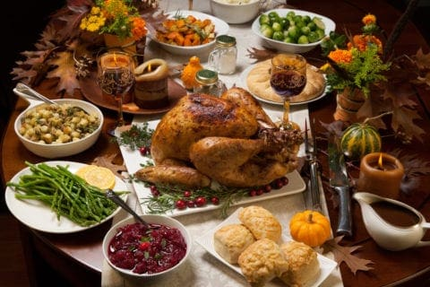 A delicious Thanksgiving meal with a turkey and all the trimmings.