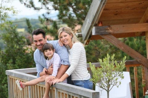 A happy family on the deck of their cabin.