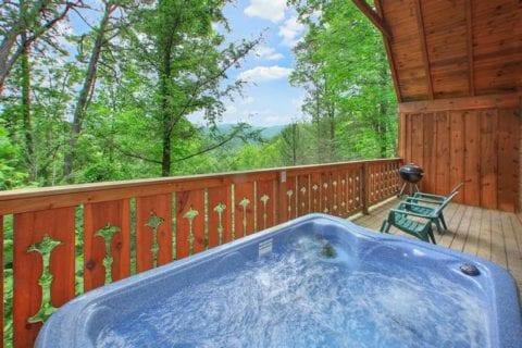 Hot tub on the deck of a romantic 1 bedroom cabin rental in Gatlinburg.