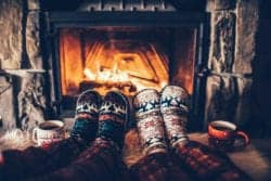 christmas socks and hot chocolate in front of fire