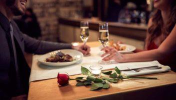 happy couple having dinner in romantic restaurant