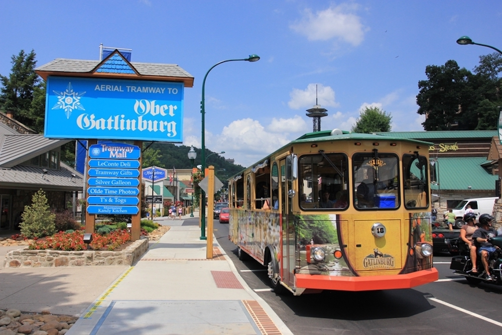 ober gatlinburg sign with trolley