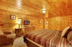 bedroom in large cabin in gatlinburg