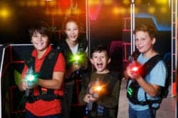 kids holding laser tag guns