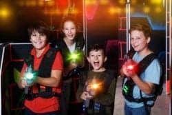 kids holding laser tag guns