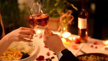 couple clinking wine glasses